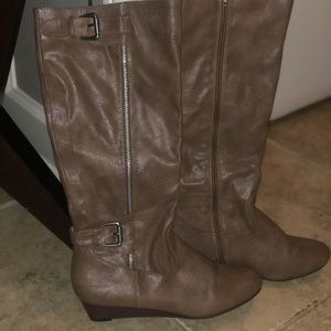 Taupe wedge boots with buckles. Never worn